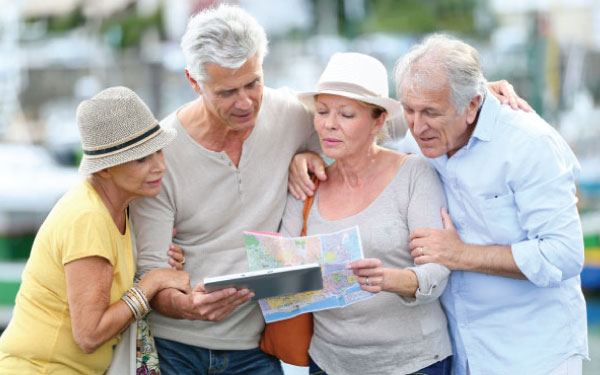 An elderly group looking at a map